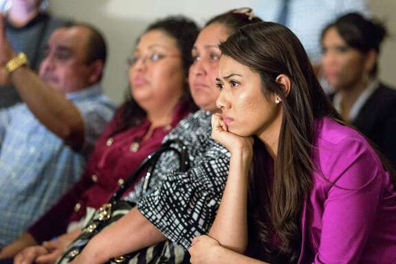 Jessica Rangel, right, watches President Barack Obama's speech at the offices of FIEL, an immigrant rights organization, in southwest Houston.
