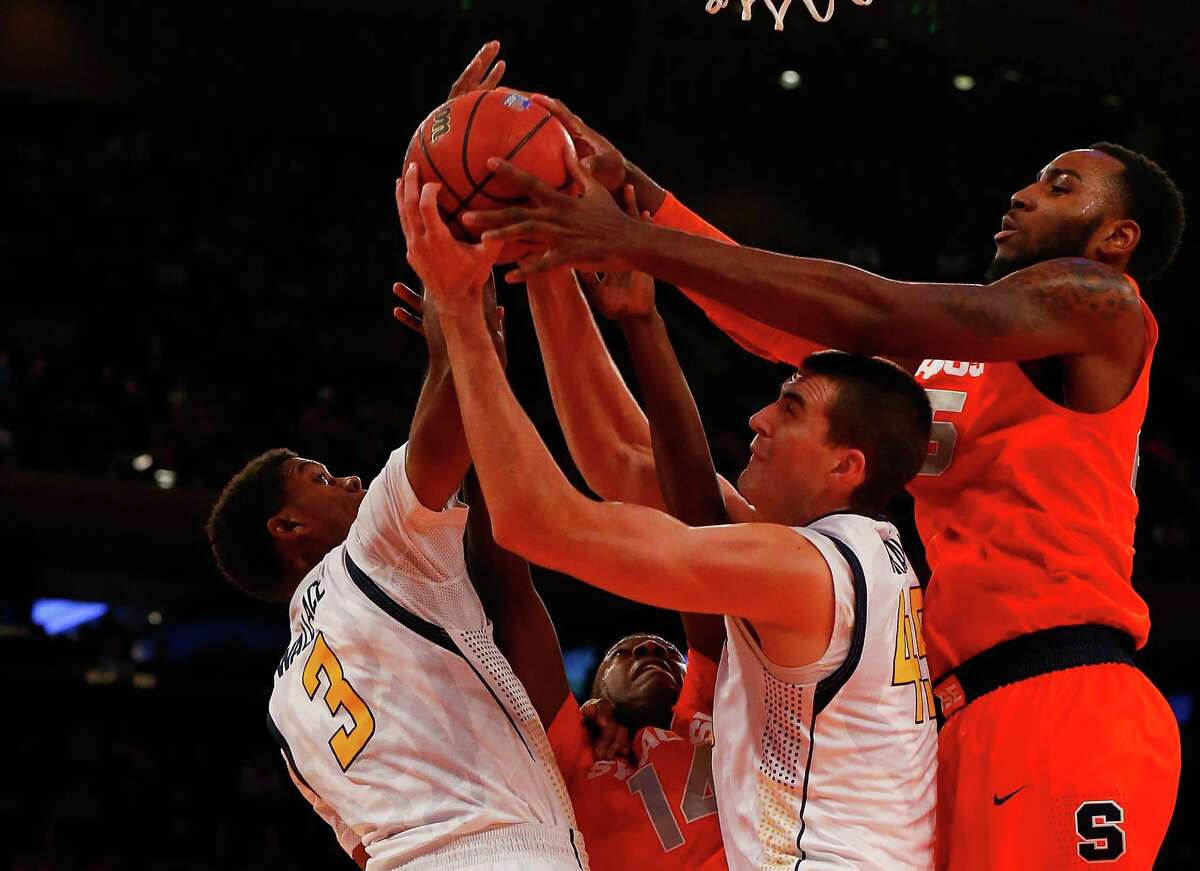Rakeem Christmas #25 and Kaleb Joseph #14 of the Syracuse Orange battle for the loose ball against Tyrone Wallace #3 and David Kravish #45 of the California Golden Bears during the 2K Classic at Madison Square Garden on November 20, 2014 in New York City.