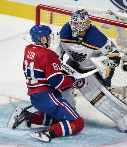 Montreal Canadiens' Lars Eller (81) falls in front of St. Louis Blues goalie Jake Allen during second-period NHL hockey game action Thursday, Nov. 20, 2014, in Montreal. (AP Photo/The Canadian Press, Paul Chiasson) ORG XMIT: PCH114 Photo: Paul Chiasson / The Canadian Press