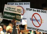 Citizens show where they stand during a public hearing on a proposed 137,000 square-foot Walmart on Thursday, Nov. 20, 2014, at Ballston Spa High in Ballston Spa, N.Y. (Cindy Schultz / Times Union)