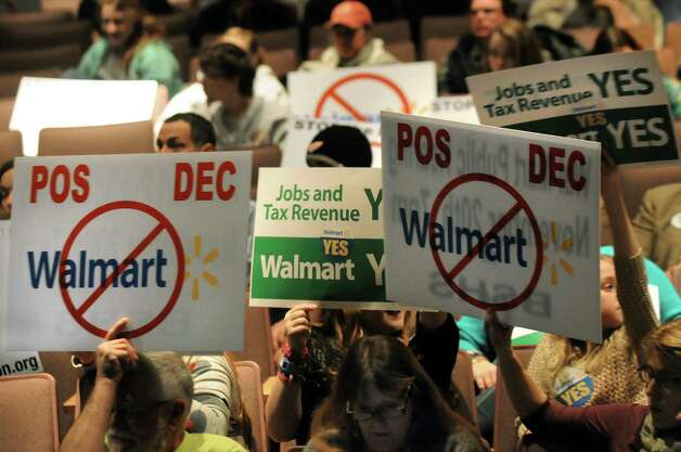Citizens show where they stand during a public hearing on a proposed 137,000 square-foot Walmart on Thursday, Nov. 20, 2014, at Ballston Spa High in Ballston Spa, N.Y. (Cindy Schultz / Times Union) Photo: Cindy Schultz / 00029572A