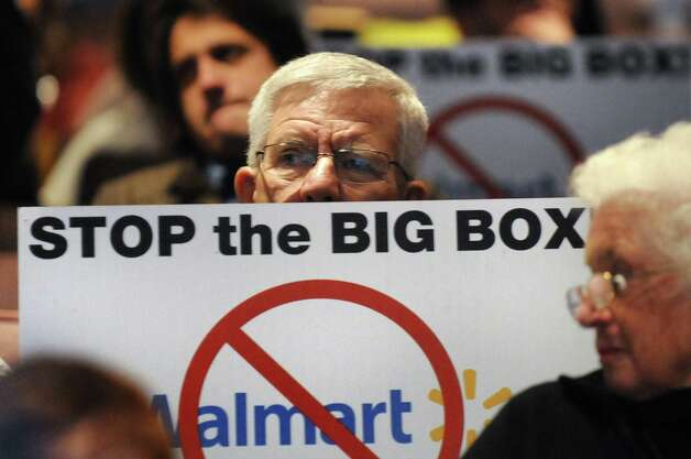 Resident Robert DeMayo shows his opposition during a public hearing on a proposed 137,000 square-foot Walmart on Thursday, Nov. 20, 2014, at Ballston Spa High in Ballston Spa, N.Y. (Cindy Schultz / Times Union) Photo: Cindy Schultz / 00029572A