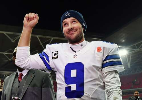 FILE - In this Nov. 9, 2014, file photo, Dallas Cowboys quarterback Tony Romo acknowledges spectators after the team's 31-17 victory over the Jacksonville Jaguars in an NFL football game at Wembley Stadium in London. Romo will play the New York Giants on Sunday night, Nov. 23, then figure out if his surgically repaired back can hold up for the quick Thanksgiving turnaround. (AP Photo/Tim Ireland, File) Photo: Tim Ireland, STR / Associated Press / AP