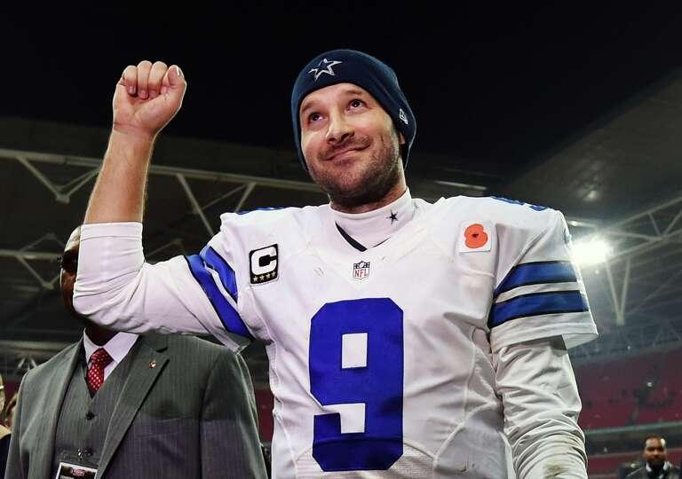 FILE - In this Nov. 9, 2014, file photo, Dallas Cowboys quarterback Tony Romo acknowledges spectator