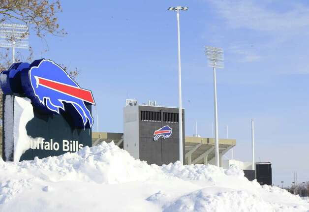 Snow covers  a sign at Ralph Wilson Stadium,  home of the Buffalo Bills in Orchard Park, N.Y. on Wednesday, Nov. 19, 2014.  A ferocious lake-effect storm left the Buffalo area buried under 6 feet of snow Wednesday, trapping people on highways and in homes, and another storm expected to drop 2 to 3 feet more was on its way. (AP Photo/The Buffalo News, Harry Scull Jr.)  TV OUT; MAGS OUT; MANDATORY CREDIT; BATAVIA DAILY NEWS OUT; DUNKIRK OBSERVER OUT; JAMESTOWN POST-JOURNAL OUT; LOCKPORT UNION-SUN JOURNAL OUT; NIAGARA GAZETTE OUT; OLEAN TIMES-HERALD OUT; SALAMANCA PRESS OUT; TONAWANDA NEWS OUT    ORG XMIT: NYBUE104 Photo: Harry Scull Jr. / The Buffalo News