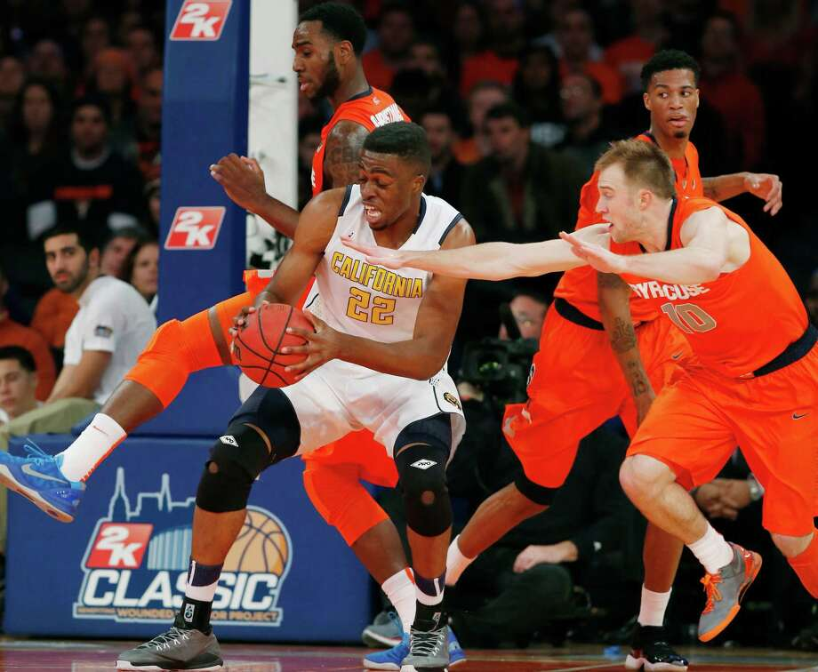 Syracuse guard Trevor Cooney (10) tries to steal the ball from California center Kingsley Okoroh (22) in the first half of an NCAA basketball game at Madison Square Garden in New York, Thursday, Nov. 20, 2014.  (AP Photo/Kathy Willens) ORG XMIT: MSG120 Photo: Kathy Willens / AP