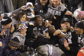 Raiders fullback Marcel Reece, who had several key carries in the winning drive, celebrates with fans after the victory.