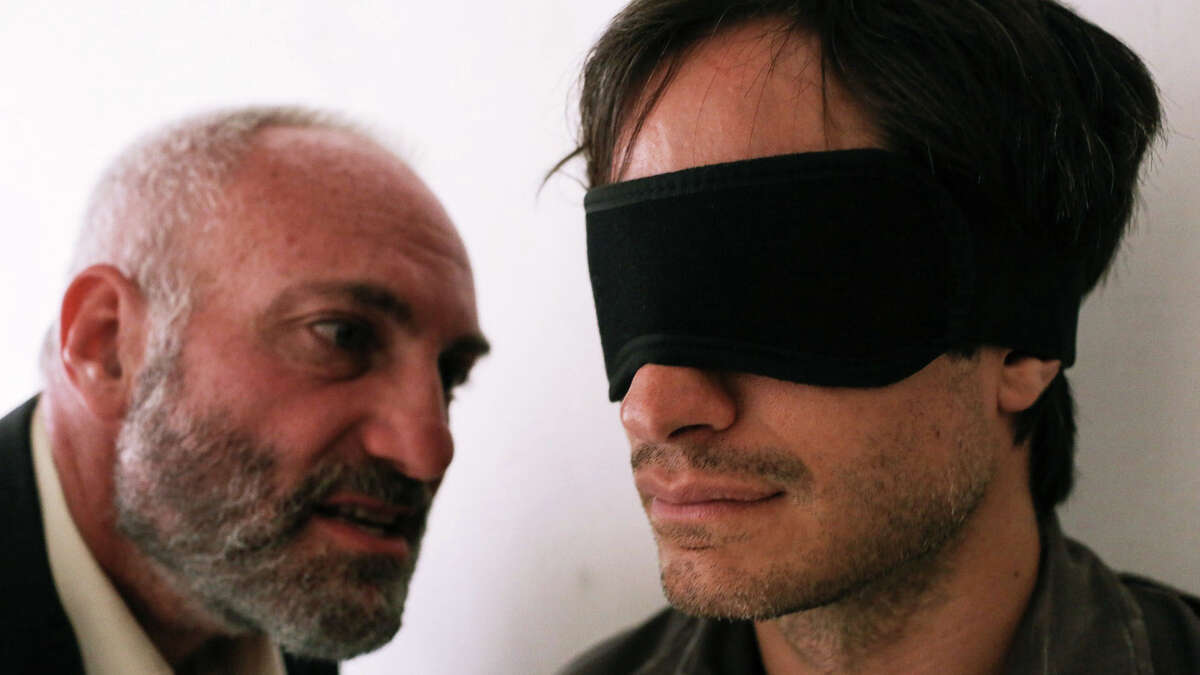 """Gael Garcia Bernal, right, portrays a journalist imprisoned by Iran in the new movie, """"Rosewater."""""""