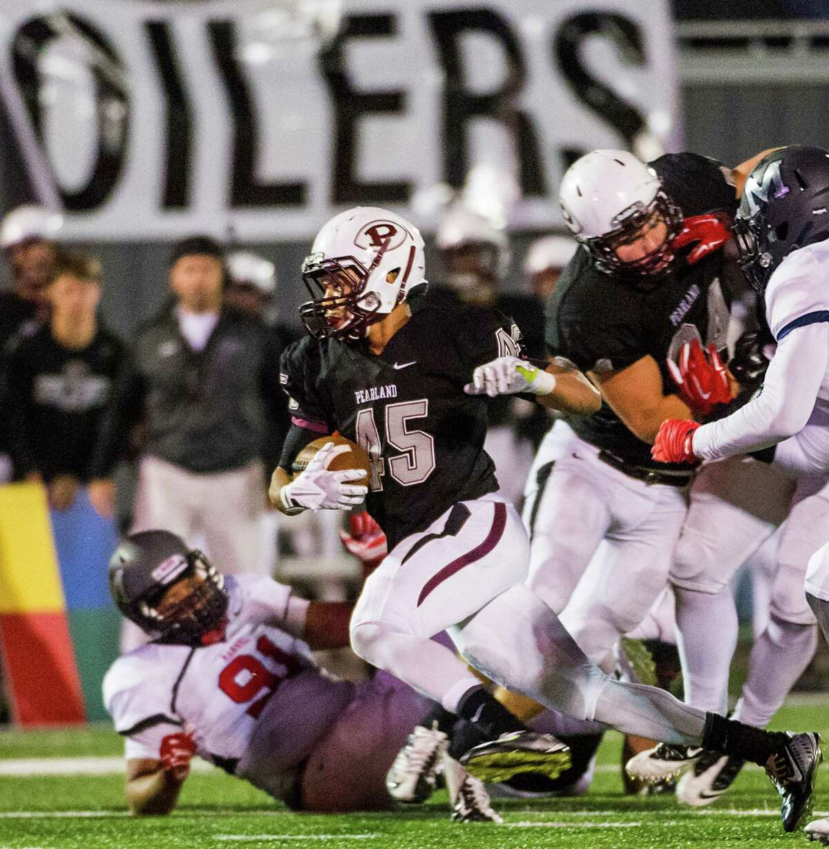 Pearland running back Davier Pinkston (45) races through the Manvel defense during the second half of a high school football game at The Rig, Friday, Nov. 7, 2014, in Pearland. ( Smiley N. Pool / Houston Chronicle )