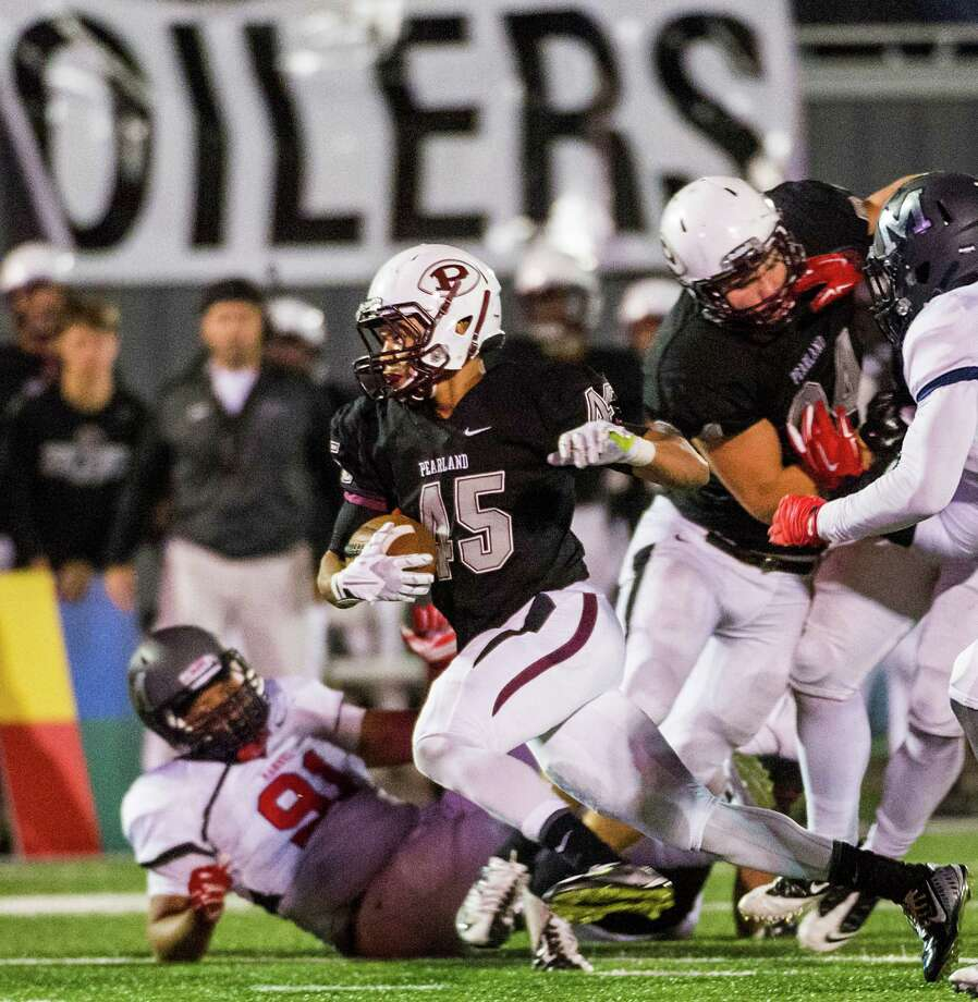 Pearland running back Davier Pinkston (45) races through the Manvel defense during the second half of a high school football game at  The Rig, Friday, Nov. 7, 2014, in Pearland. ( Smiley N. Pool / Houston Chronicle ) Photo: Smiley N. Pool, Staff / © 2014  Houston Chronicle