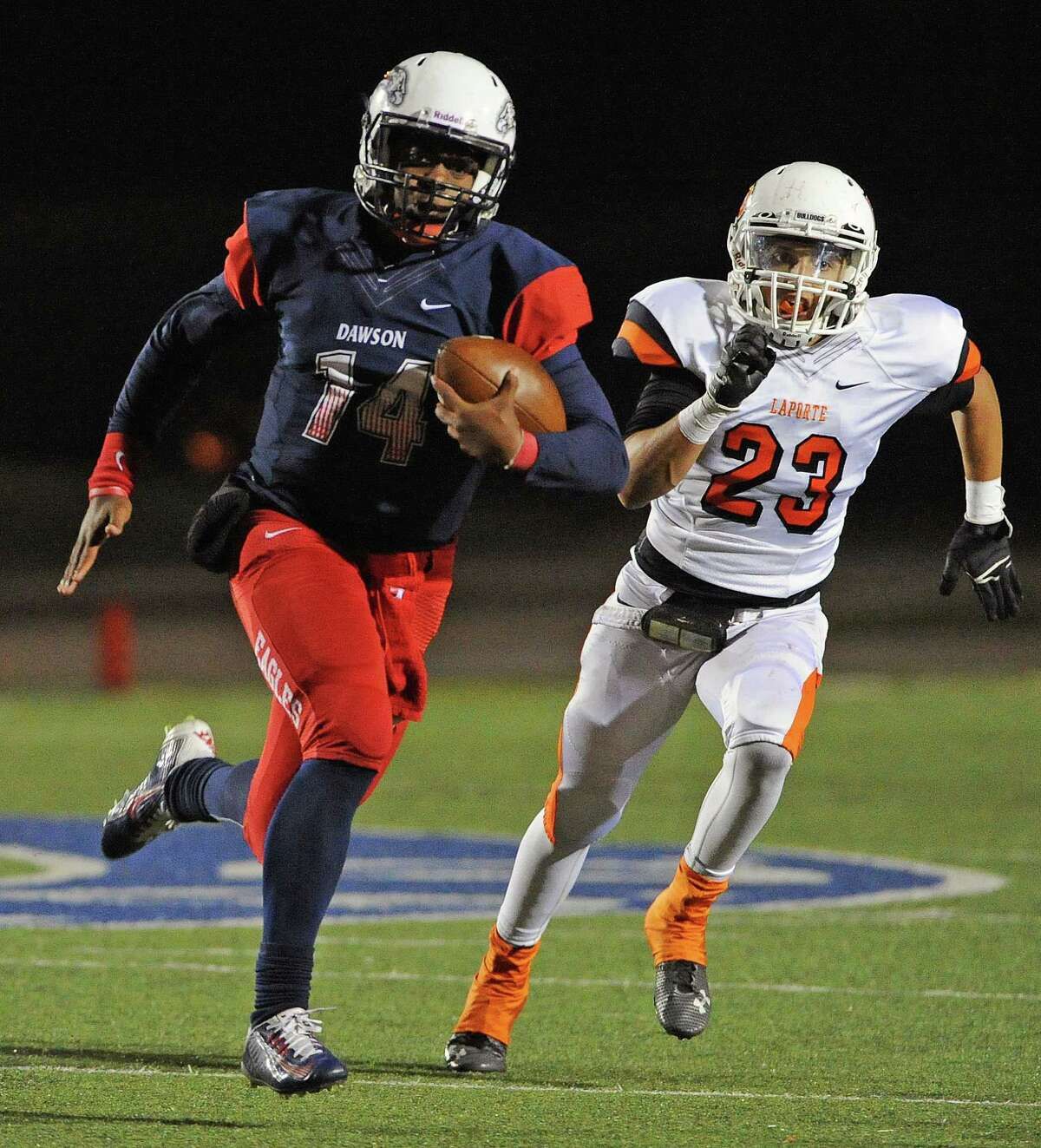 Dawson quarterback Vance Galloway, left, scampers past La Porte defensive back Lane Pfieffer during the second half of a high school football game, Friday, November 14, 2014, at Galena Park ISD Stadium in Houston. (Photo: Eric Christian Smith/For the Chronicle)
