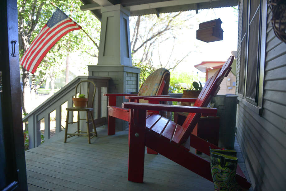 Andy Rogers made the red adirondack chairs on the front porch from bunk bed frames. He and his wife, Tanya, and their daughters enjoy projects for their 1920s cottage in New Braunfels. Photo: Robin Jerstad, Freelance