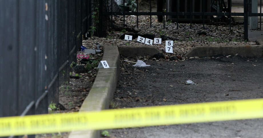 Evidence markers are in place while San Antonio police investigate the scene of a shooting that took place Friday morning November 21, 2014 on the 3700 block of West Avenue. San Antonio Police Department spokesman Douglas Greene said a fight broke out between a group of men that escalated into a shooting leaving two men shot with multiple wounds that were transported to University Hospital. The suspects that fired the shots have not yet been located Greene said. Photo: JOHN DAVENPORT, San Antonio Express-News / ©San Antonio Express-News/John Davenport