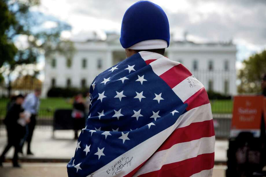 Immigration reform can be achieved if Congress and the president stop treating the issue as blood sport. Photo: Andrew Harrer / Andrew Harrer / Bloomberg / © 2014 Bloomberg Finance LP