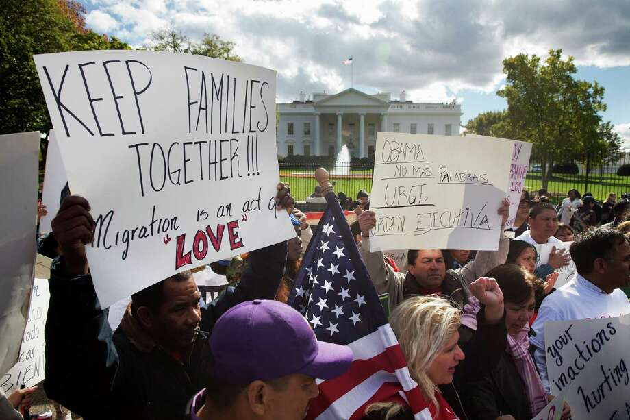 In this file photo, people rally for comprehensive immigration reform outside the White House. Comprehenisve reform is the solution, but that takes work. And it is such a dandy issue of the 2016 election. Photo: Jacquelyn Martin /Associated Press / AP