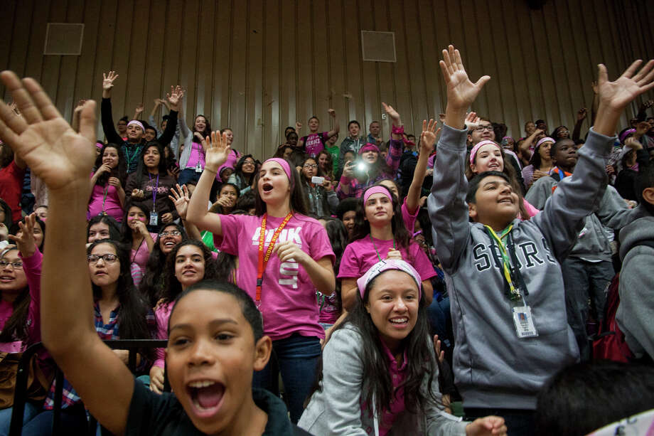 About 1,300 students gathered along with faculty during a pep rally held in honor of english and reading teacher Katherine Martz, who is battling breast cancer, Friday November 21, 2014 at Kitty Hawk Middle School. More than one thousand dollars were raised after students have been selling and wearing bandannas in support of her. Photo: Julysa Sosa / Julysa Sosa For the San Antonio Express-News