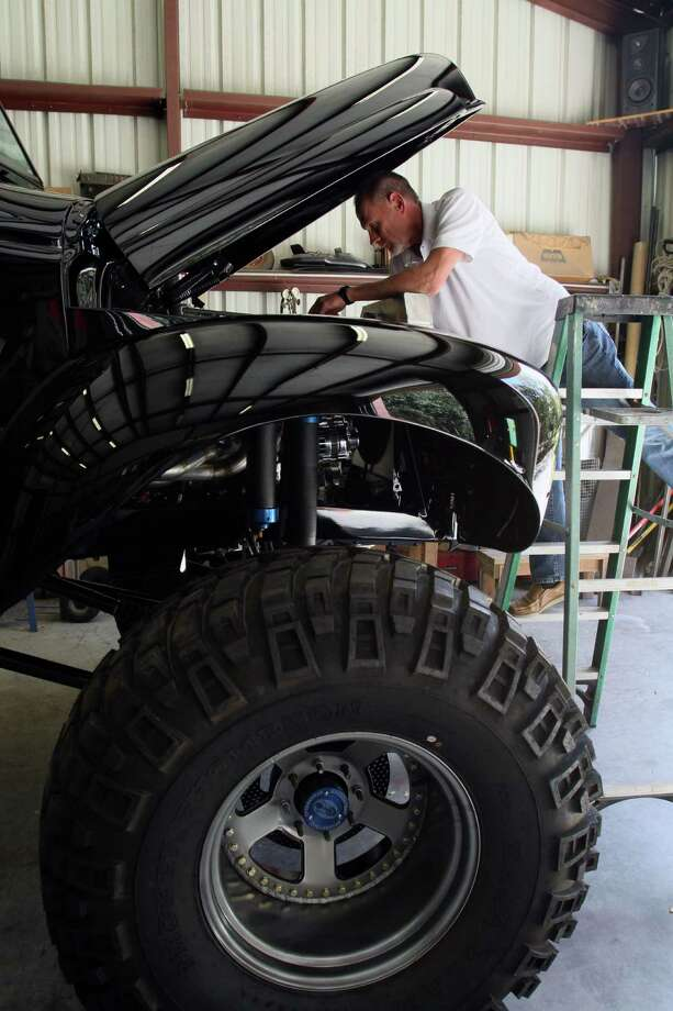 "A.L. Mayo often requires a ladder to work on his ""Monster International,"" a radical makeover of a 1948 International pickup truck. / (c) Jeffrey Yip 2014"