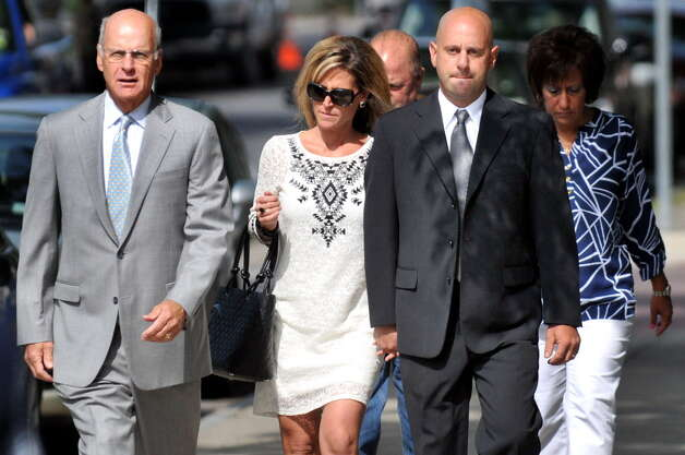 Troy Police Officer Brian Gross, right, walks with attorney Steve Coffey, left, to face evidence tampering charges on Wednesday, July 30, 2014, at City Court in Troy, N.Y. (Cindy Schultz / Times Union) Photo: Cindy Schultz