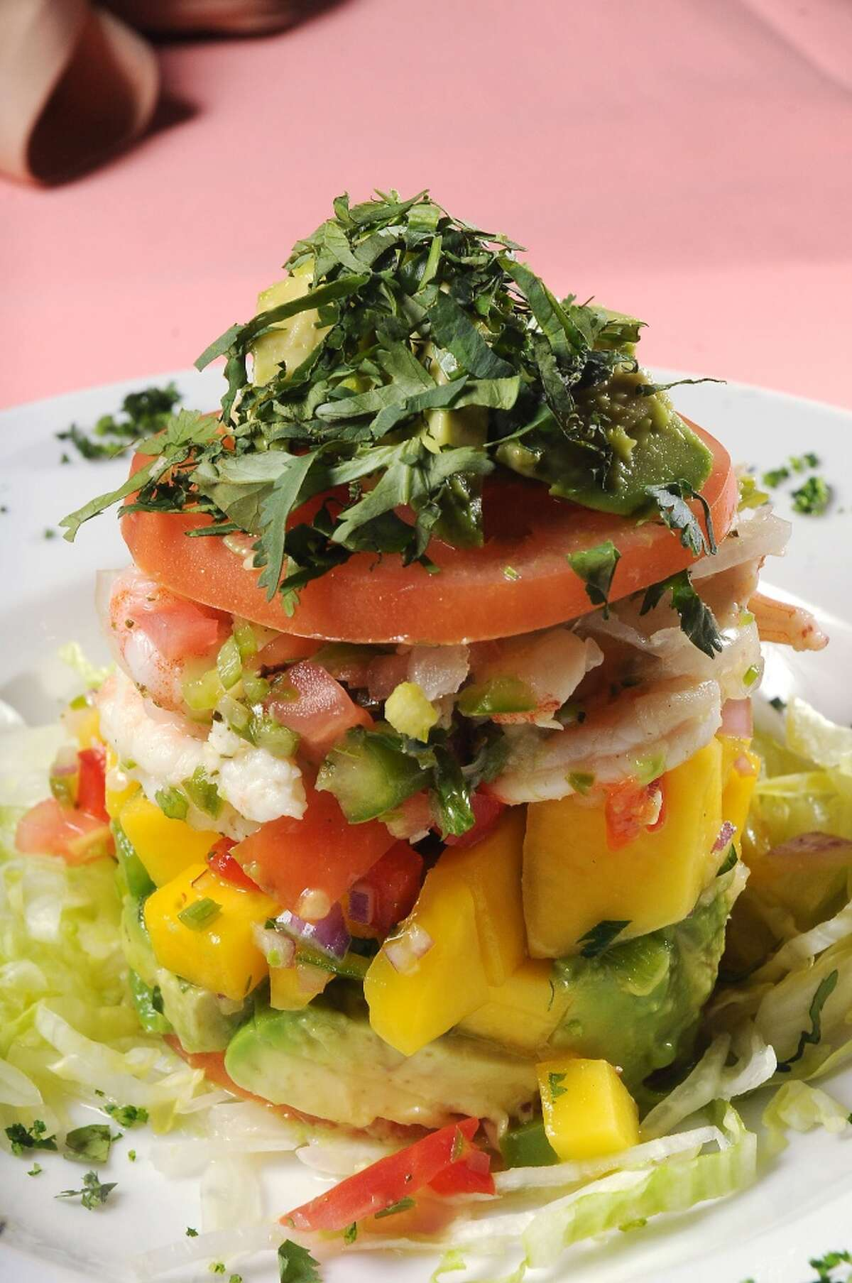 The napoleon de Ceviche: Tower of lime-marinated snapper and gulf shrimp with pico de mango and avocado at the new Pico's Mex-Mex restaurant on Kirby at Richmond Tuesday March 11, 2014.(Dave Rossman photo)