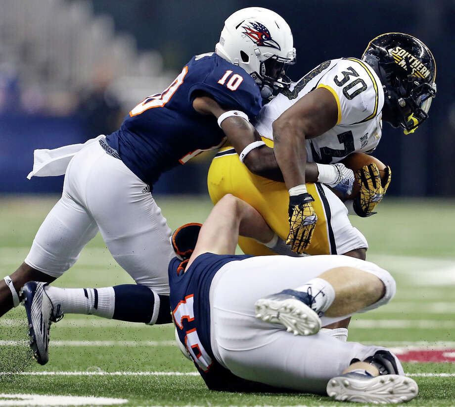 Southern Mississippi's Jalen Richard tries to shake the tackle of UTSA's Brian King (left) and Richard Burge during second half on Nov. 13 at the Alamodome. UTSA won 12-10. Photo: Edward A. Ornelas, Staff / San Antonio Express-News / © 2014 San Antonio Express-News