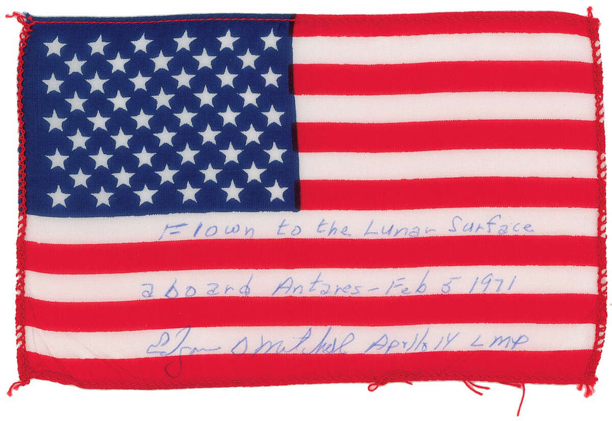 American flag carried to lunar surface. Final price at auction: $27,121.