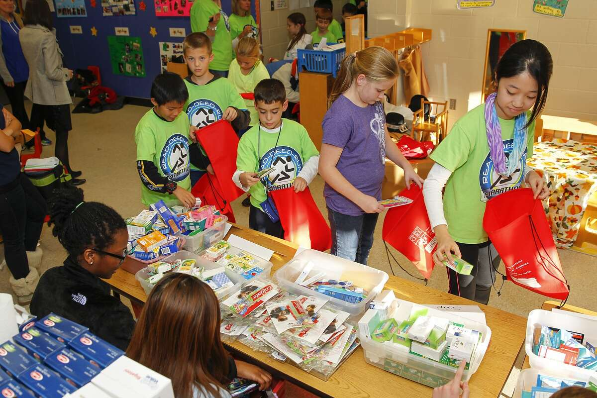 Pupils at Pattison Elementary in Katy help pack medical kits for the Katy for Kids project that will send kits to needy families all over the world.
