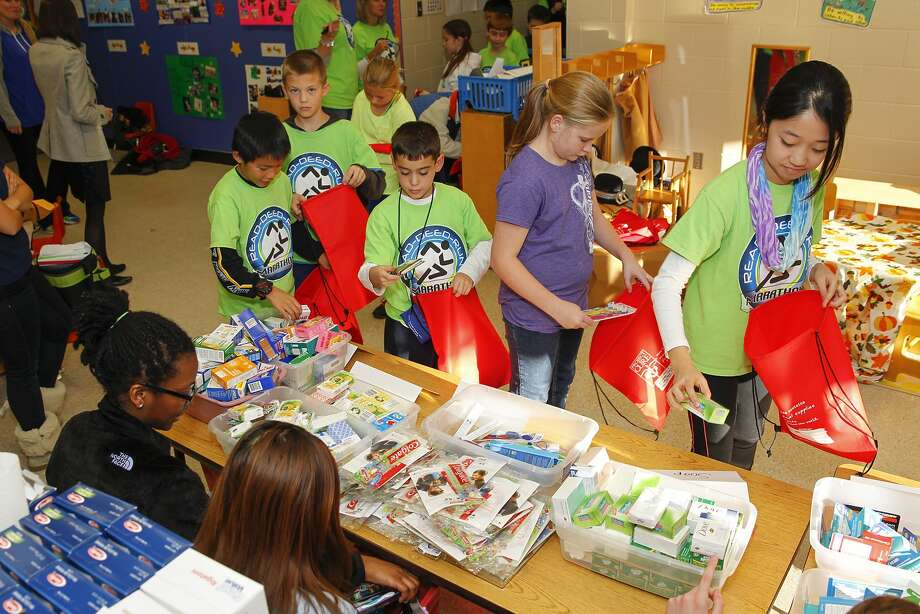 Pupils at Pattison Elementary in Katy help pack medical kits for the Katy for Kids project that will send kits to needy families all over the world. Photo: Diana L. Porter, Freelance / © Diana L. Porter