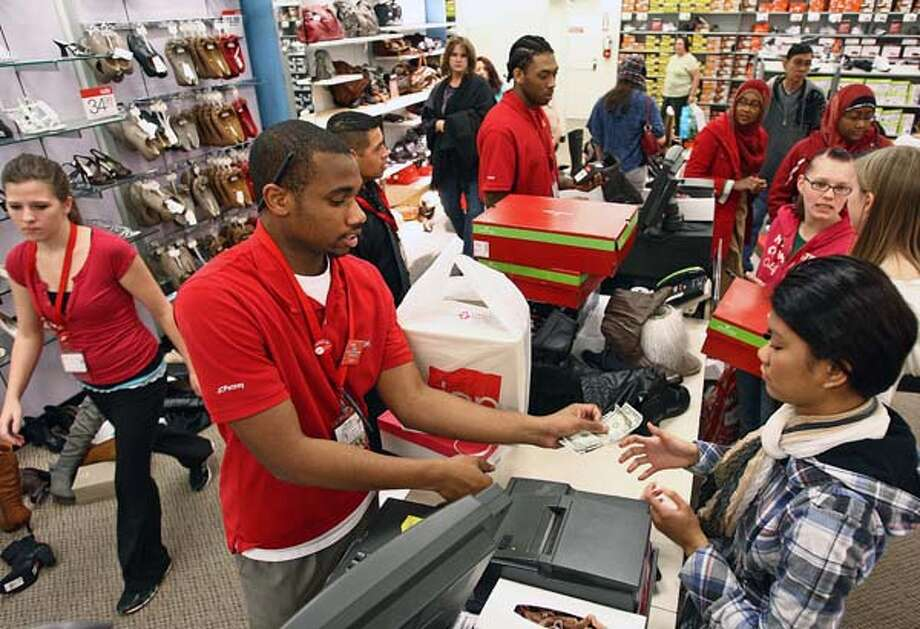Black Friday shoppers check out at JCPenney at Westfield Southcenter Mall in Tukwila, Wash., on Friday, Nov. 25, 2011. (AP Photo/The Seattle Times, Aaron Jaffe )  MAGS OUT; NO SALES; SEATTLEPI.COM OUT; MANDATORY CREDIT; USA TODAY OUT; MANDATORY CREDIT; TV OUT Photo: Aaron Jaffe, Multiple / The Seattle Times