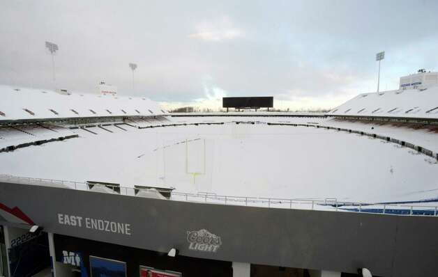 """Snow covers the seats and field at Ralph Wilson Stadium in Orchard Park, N.Y. Friday, Nov. 21, 2014. Snowed out in Buffalo, the Bills are heading to Detroit to play their """"home"""" NFL football game against the New York Jets on Monday night, Nov. 24, 2014. (AP Photo/Gary Wiepert) ORG XMIT: NYGW104 Photo: Gary Wiepert, AP / FR170498 AP"""
