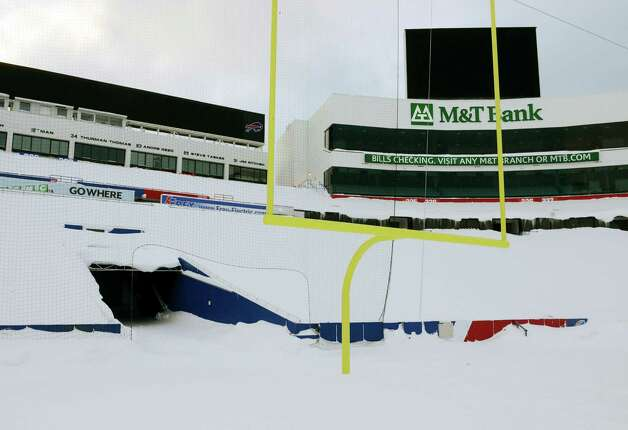 "Snow covers the seats and field at Ralph Wilson Stadium in Orchard Park, N.Y. Friday, Nov. 21, 2014. Snowed out in Buffalo, the Bills are heading to Detroit to play their ""home"" NFL football game against the New York Jets on Monday night, Nov. 24, 2014. (AP Photo/Gary Wiepert) ORG XMIT: NYGW106 Photo: Gary Wiepert, AP / FR170498 AP"