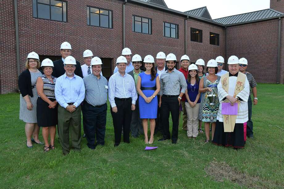 On Aug. 12, St. John XXIII celebrated the ground breaking for the Father Joe Crosthwait Student Center as part of the Inspire Pride Campaign. The school staff and board participated. On Aug. 12, St. John XXIII celebrated the ground breaking for the Father Joe Crosthwait Student Center as part of the Inspire Pride Campaign. The school staff and board participated. On Aug. 12, St. John XXIII celebrated the ground breaking for the Father Joe Crosthwait Student Center as part of the Inspire Pride Campaign. The school staff and board participated. Photo: Courtesy St. John XXIII College
