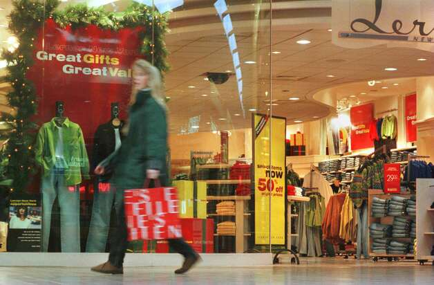 In this 1997 archive image, a shopper walks past a store at Rotterdam Square Mall.  (Paul Buckowski/Times Union archive) Photo: PAUL BUCKOWSKI / ALBANY TIMES UNION