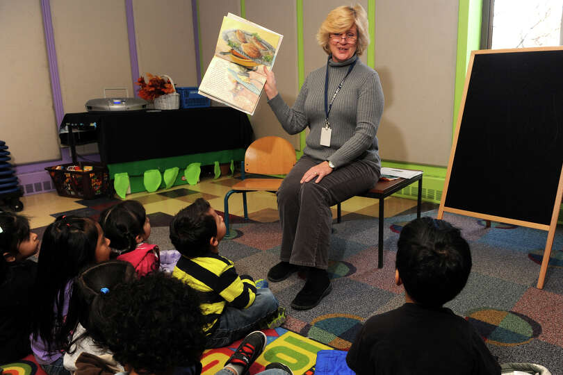Cindy Lappala reads ìOne Is a Feast for Mouseî, a Thanksgiving tale by author Judy Cox, to Pre-K s