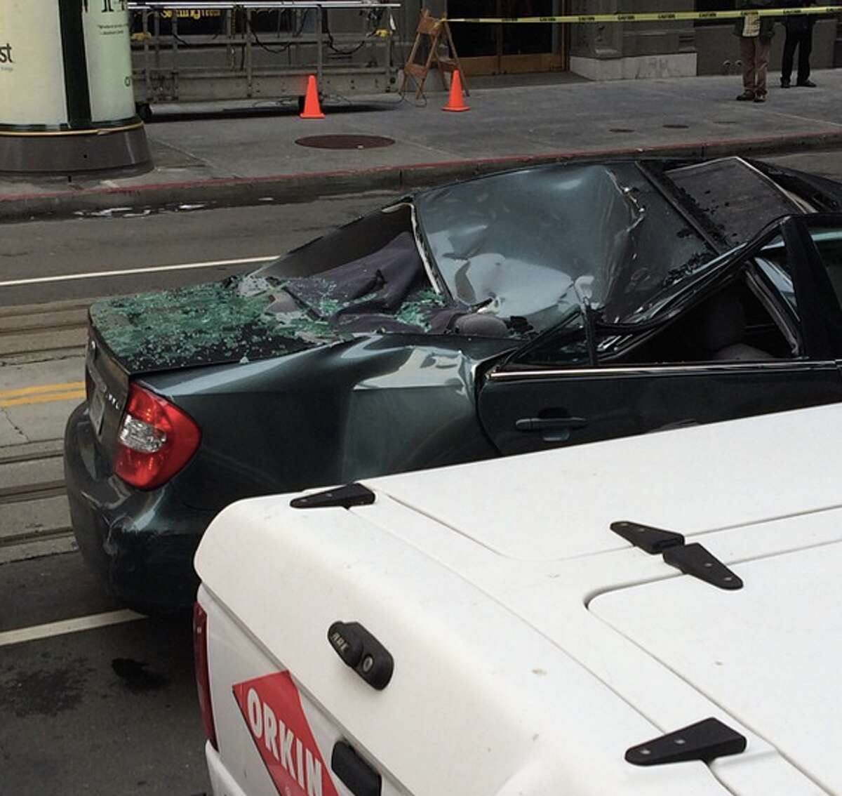 Instagram userradiopadraic posted this photo showing a car that a worker landed on after falling off a building near Montgomery and California streets in San Francisco on on Friday, November 21, 2014.