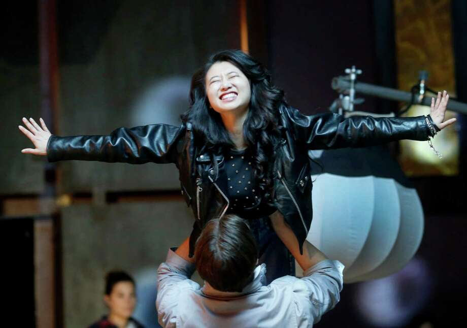 "Annie Q and Pierson Fodé practice a stunt during the nightclub scene in ""Cardinal X,"" Angie Wang's directing debut. Photo: Brant Ward / The Chronicle / ONLINE_YES"