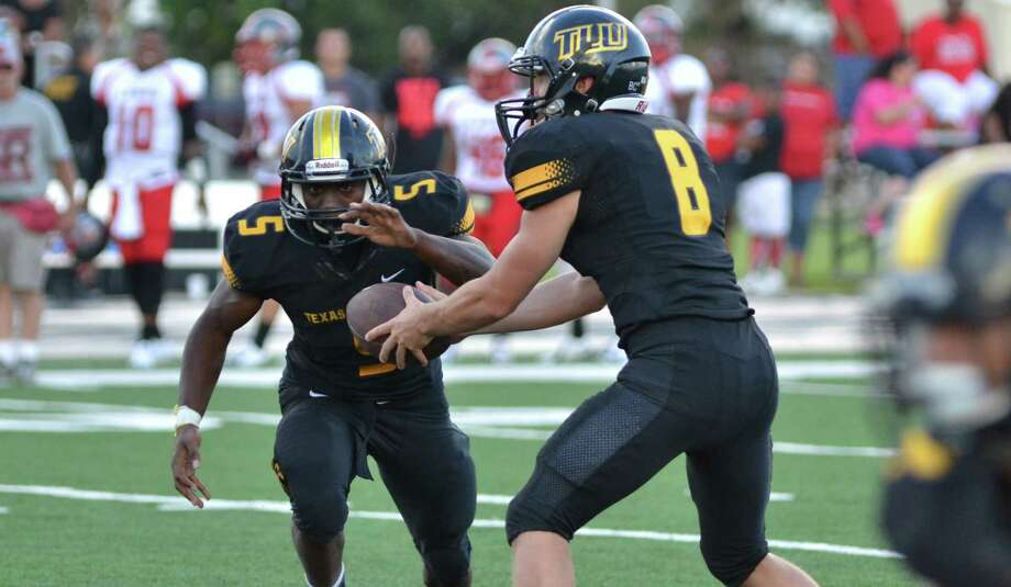 Running back Marquis Barrolle (left) and quarterback Trenton White have helped lead Texas Lutheran to its first NCAA Division III playoff appearance. The Bulldogs will face No. 2-ranked Mary Hardin-Baylor at noon Saturday in Belton. Photo: Courteys Photo, Courtesy Photo
