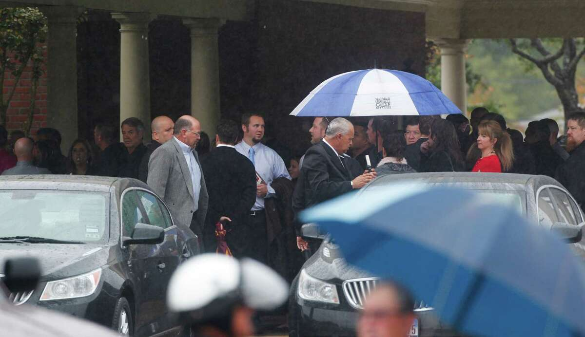 """Overflow waits outside of the Grand View Funeral Home and Memorial Park during the funeral's of brothers, Robert Tisnado, 39, and Gilbert """"Gibby"""" Tisnado, 48 who died in a hazardous chemical leak at a DuPont plant in La Porte last weekend. /"""