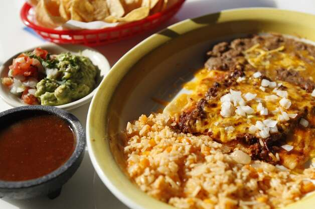 Bryan Caswell and Bill Floyd*El Real Tex-MexWhere:1201 Westheimer  Photo: cheese enchiladas *In partnership with cookbook author Robb Walsh Photo: Melissa Phillip, Houston Chronicle