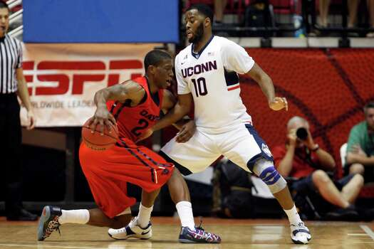 UConn guard Sam Cassell Jr., right, pressures Dayton guard Jordan Sibert during a NCAA college basketball game in San Juan, Puerto Rico, Friday, Nov. 21, 2014. Photo: Ricardo Arduengo, AP / Associated Press