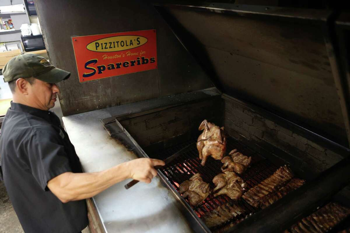 PIzzitola's Bar-B-Cue David Reynoso handles meat cooking in the brick pit at Pizzitola's Barbecue. The restaurant has been on Shepherd for many years after moving from its original location due to the construction of Interstate 10.