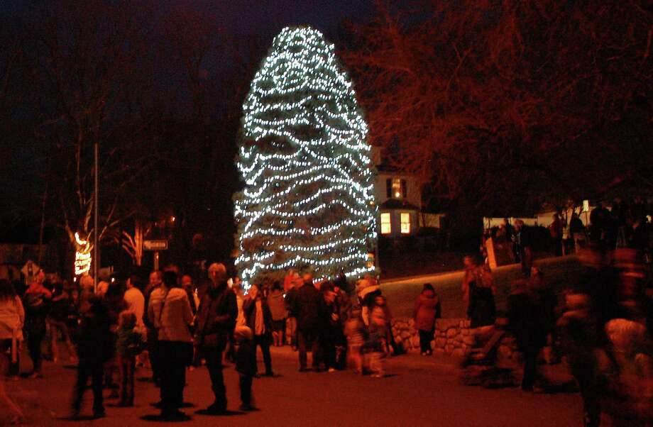 Last year, hundreds turnout on the town hall lawn for the lighting of the town Christmas tree. This year, the lighting is planned at 5 p.m. on Wednesday, Dec. 3, followed by a free community party at Christ & Holy Trinity Church sponsored by the Downtown Merchants Association. Photo: Jarret Liotta / Westport News contributed
