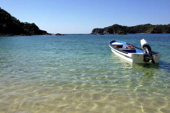 A boat in a quiet bay where snorkelers visit in Huatulco, Mexico.