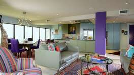 Sydney Greenblatt and Ward White wanted an open kitchen, so they tore out the interior walls. Then came the color: Almost every wall in the condo is painted a different shade.