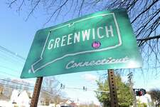 The Greenwich, Connecticut, sign on West Putnam Avenue in the Byram section of Greenwich, Conn., Friday afternoon, Nov. 21, 2014. Greenwich was named the safest big city in the state of Connecticut by researchers at ValuePenguin, coming in with the lowest crime rate for cities with a population of more than 45,000 people.