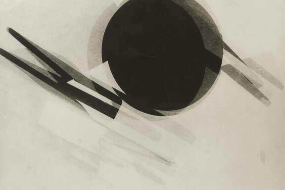 """Among works on view in """"Shadows on the Wall: Cameraless Photography from 1851 to Today"""" through Nov. 30 at the Museum of Fine Arts, Houston:  Lé¡szlé³ Moholy-Nagy, Untitled, 1926, gelatin silver print, photogram, the Museum of Fine Arts, Houston, Museum purchase funded by the Caroline Wiess Law Accessions Endowment Fund, The Manfred Heiting Collection. 2014 Artists Rights Society (ARS), New York I VG Bild-Kunst, Bonn"""