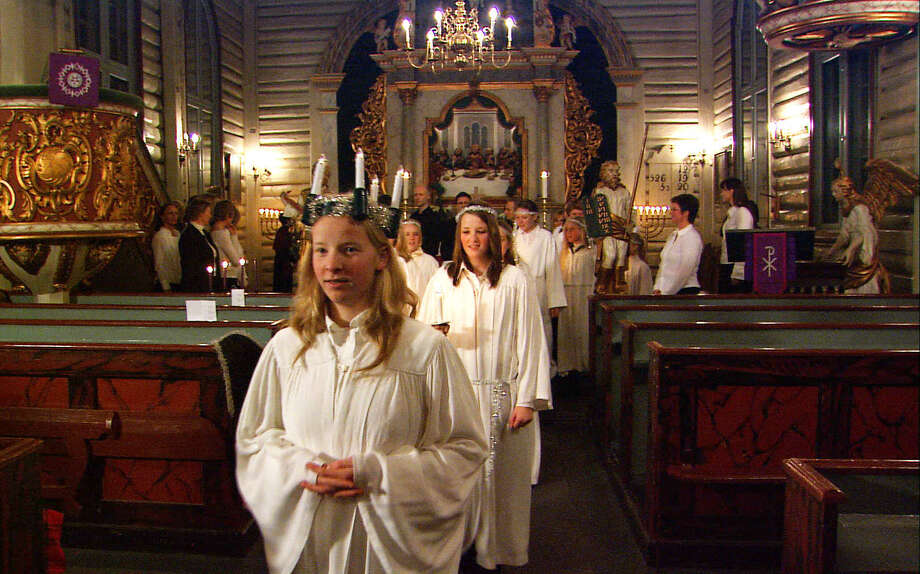Norwegian girls celebrate the feast of Santa Lucia on December 13 with a candlelight procession. Photo: Rick Steves / Rick Steves' Europe