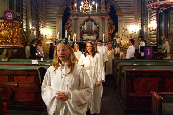 Norwegian girls celebrate the feast of Santa Lucia on December 13 with a candlelight procession.