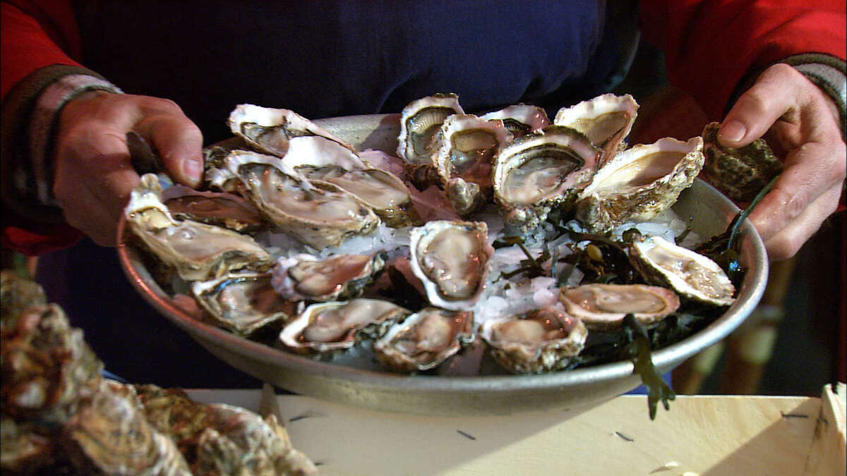 A Parisian Christmas Eve feast often begins with a plate of raw oysters.