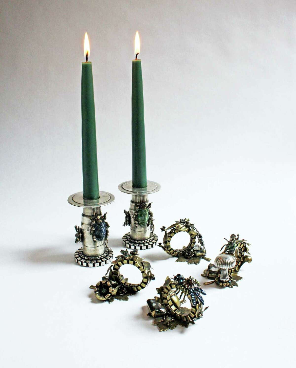 Jewelry brand Miriam Haskell has launched a home collection including nature-inspired, plated brass and silver candlesticks, $1,360 per pair, and plated brass napkin rings, $460 each.