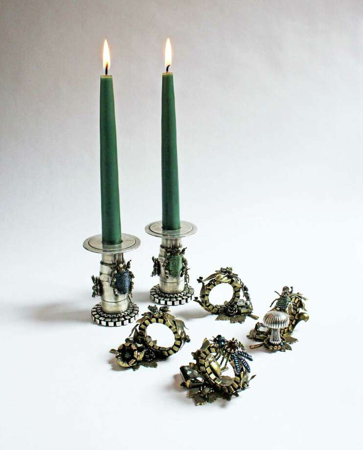 Jewelry brand Miriam Haskell has launched a home collection including nature-inspired, plated brass and silver candlesticks, $1,360 per pair, and plated brass napkin rings, $460 each. / Miriam Haskell